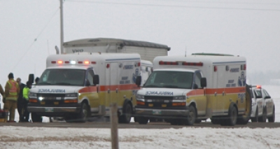 Ambulances attend an accident scene south of Boissevain in February 2016.