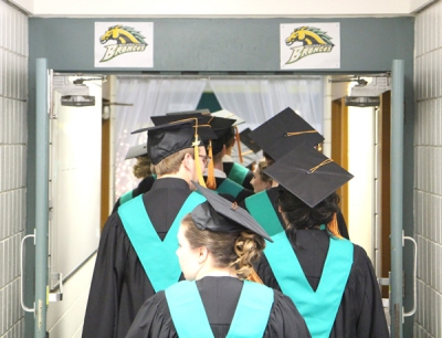 The Boissevain School Class of 2017 march into the gym to start the commencement exercises held at Boissevain School on Tuesday, June 27.